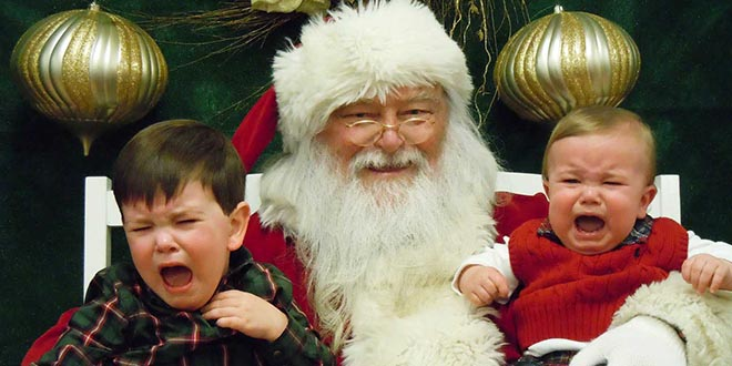 a pastor is under fire after recording himself telling children waiting in line to meet santa claus that the man in red does not exist - Santa Claus With Kids